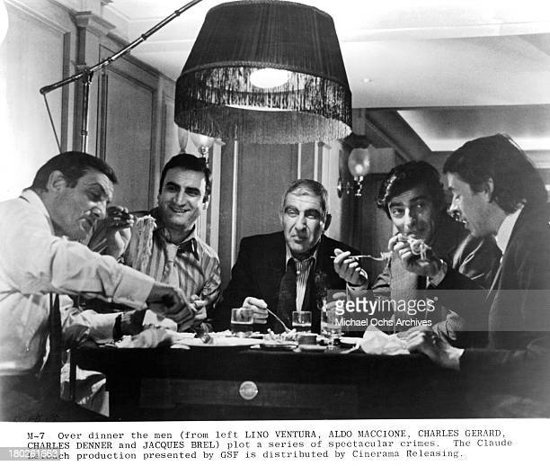 Actors Lino Ventura Aldo Maccione Charles Gerard and Charles Denner and Jacque Brel on set of Cinerama Releasing movie Money Money Money