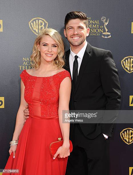 Actors Linsey Godfrey and Robert Adamson arrive at the 42nd Annual Daytime Emmy Awards at Warner Bros Studios on April 26 2015 in Burbank California
