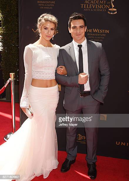 Actors Linsey Godfrey and Robert Adamson attend the 2016 Daytime Emmy Awards Arrivals at Westin Bonaventure Hotel on May 1 2016 in Los Angeles...