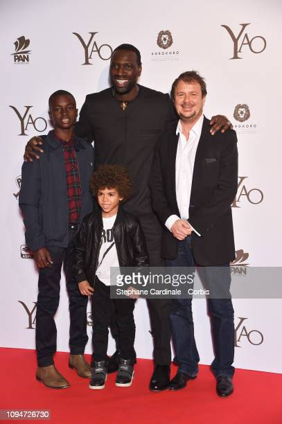 Actors Lionel LouisBasse Aristote Laios Omar Sy and director Philippe Godeau attend 'Yao' Paris Premiere at Le Grand Rex on January 15 2019 in Paris...