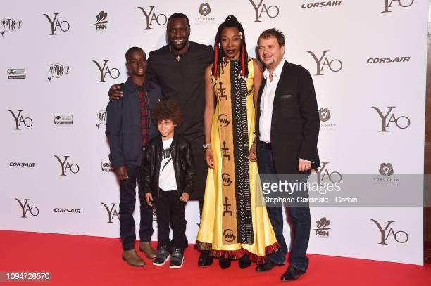 Actors Lionel LouisBasse Aristote Laios Omar Sy Fatoumata Diawara and director Philippe Godeau attend 'Yao' Paris Premiere at Le Grand Rex on January...