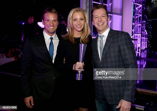 Actors Lisa Kudrow and Sean Hayes pose with the award for TV Performance of the Year Actress backstage during the PEOPLE Magazine Awards at The...