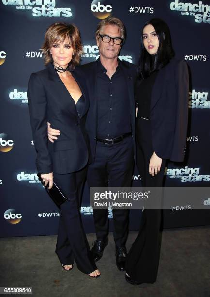 Actors Lisa Rinna and Harry Hamlin and daughter Amelia Gray Hamlin attend 'Dancing with the Stars' Season 24 premiere at CBS Televison City on March...