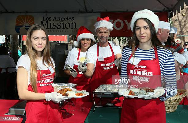 Actors Lisa Rinna and Harry Hamlin and their daughters Delilah Belle Hamlin and Amelia Gray Hamlin attend the Los Angeles Mission Christmas Eve Event...