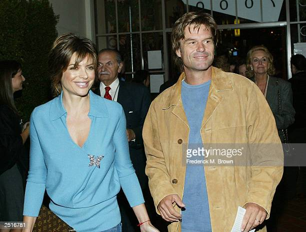 Actors Lisa Rinna and Harry Hamlin attend the after party for the film premiere of Under The Tuscan Sun at the Roosevelt Hotel on September 20 2003...