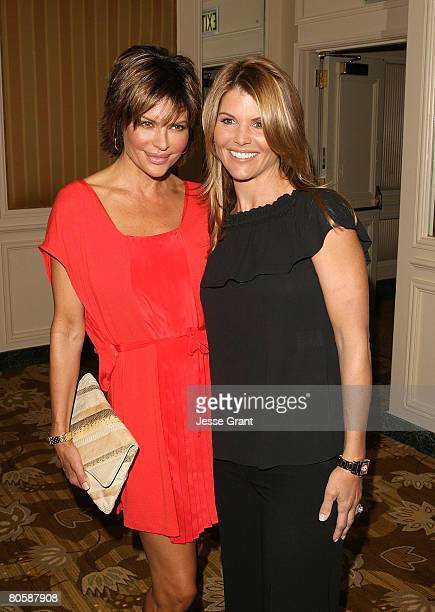 Actors Lisa Rinna and Lori Loughlin arrive at Saks Fifth Avenue's 20th Annual Spring Luncheon at the Beverly Wilshire Hotel on April 9 2008 in...