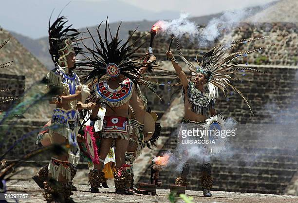 Actors lit the torch that is to be taken to the XV Pan American Games in Rio de Janeiro in an Aztec ritual at the archaeological site of Teotihuacan...