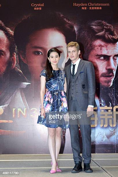 Actors Liu Yifei and Hayden Christensen attend Nick Powell's new movie 'Outcast' premiere on September 25 2014 in Shanghai China