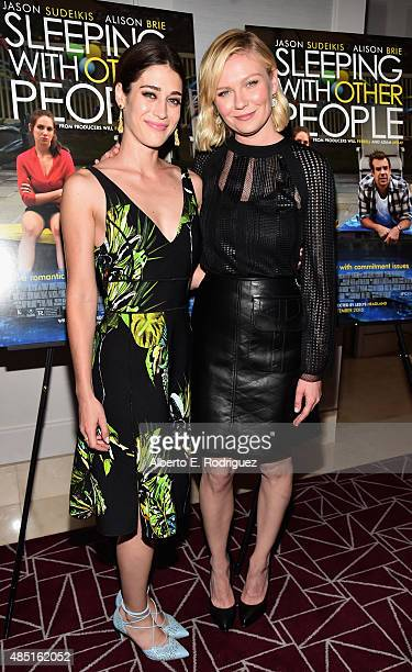 Actors Lizzy Caplan and Kirsten Dunst attend the Tastemaker screening of IFC Films' 'Sleeping With Other People' on August 24 2015 in Los Angeles...