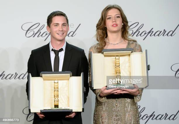 Actors Logan Lerman and Adele Exarchopoulos accept awards onstage at the Chopard Trophy during the 67th Annual Cannes Film Festival on May 15 2014 in...