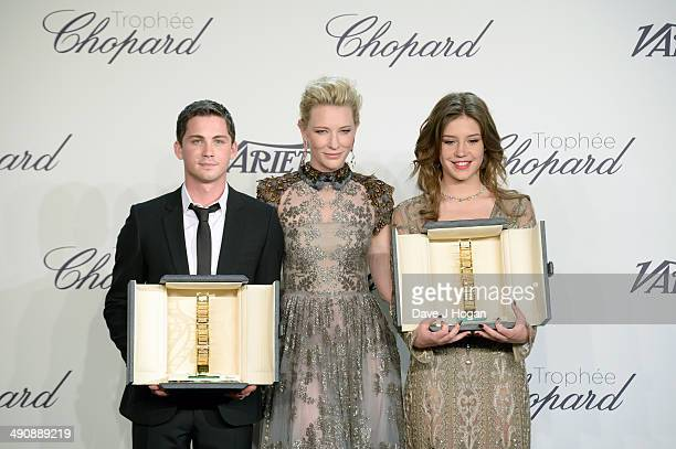 Actors Logan Lerman Cate Blanchett and Adele Exarchopoulos pose onstage at the Chopard Trophy during the 67th Annual Cannes Film Festival on May 15...