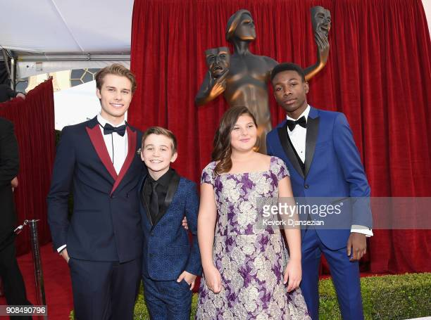 Actors Logan Shroyer Parker Bates Mackenzie Hancsicsak and Niles Fitch attend the 24th Annual Screen ActorsGuild Awards at The Shrine Auditorium on...