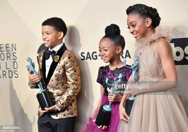 Actors Lonnie Chavis Faithe C Herman and Eris Baker pose in the press room during the 24th Annual Screen ActorsGuild Awards at The Shrine Auditorium...