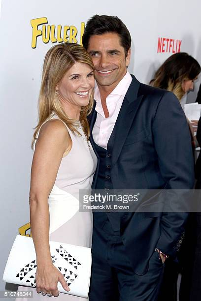 Actors Lori Loughlin and John Stamos attend the premiere of Netflix's Fuller House at Pacific Theatres at The Grove on February 16 2016 in Los...