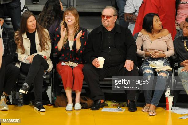 Actors Lorraine Nicholson and Jack Nicholson attend a basketball game between the Los Angeles Lakers and the Golden State Warriors at Staples Center...
