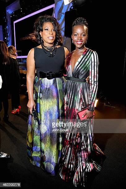 Actors Lorraine Toussaint and Lupita Nyong'o backstage at TNT's 21st Annual Screen Actors Guild Awards at The Shrine Auditorium on January 25, 2015...