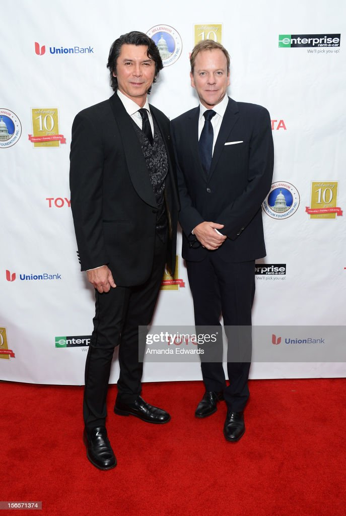 Actors Lou Diamond Phillips (L) and Kiefer Sutherland arrive at the 10th Annual Opening Doors Awards benefiting the Millennium Momentum Foundation at Dorothy Chandler Pavilion on November 16, 2012 in Los Angeles, California.