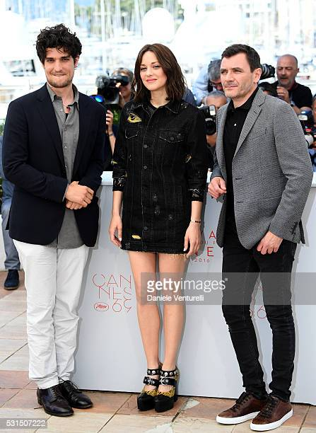 Actors Louis Garrel Marion Cotillard and Alex Brendemuehl attend the From The Land Of The Moon photocall during the 69th annual Cannes Film Festival...