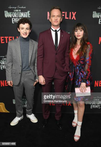 Actors Louis Hynes Neil Patrick Harris and Malina Weissman attend the Netflix Premiere of 'A Series of Unfortunate Events' Season 2 on March 29 2018...