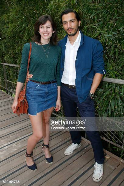 Actors Louise Monot and her companion Samir Boitard attend the 2017 French Tennis Open - Day Height at Roland Garros on June 4, 2017 in Paris, France.