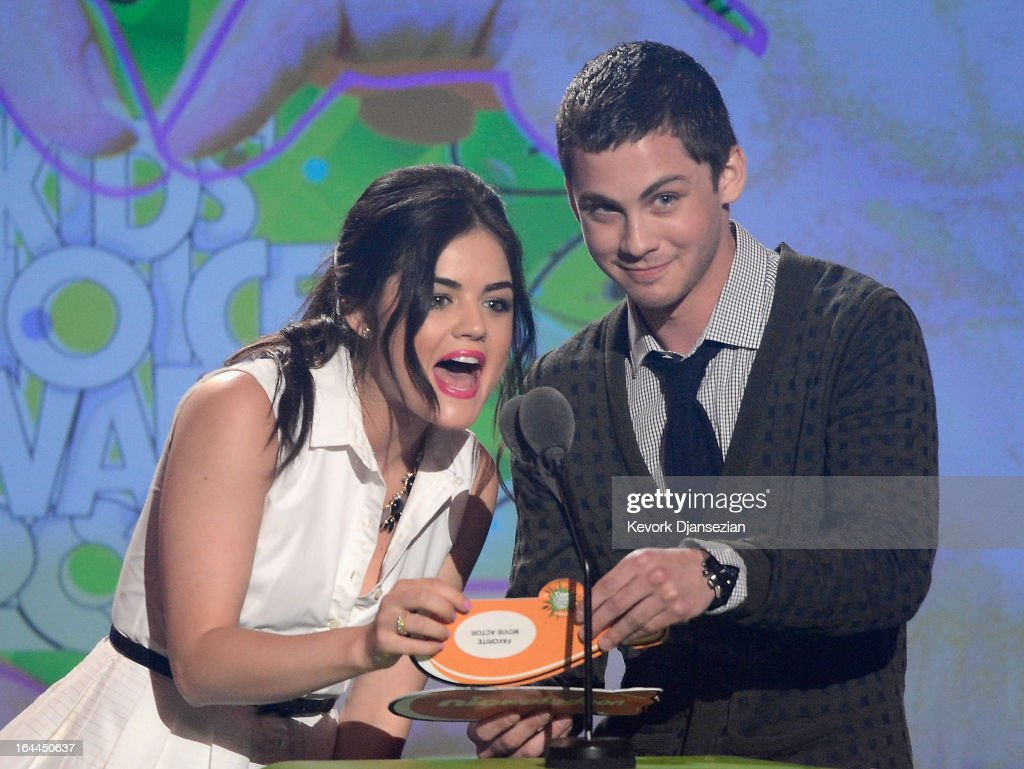 Actors Lucy Hale (L) and Logan Lerman speak onstage during Nickelodeon's 26th Annual Kids' Choice Awards at USC Galen Center on March 23, 2013 in Los Angeles, California.