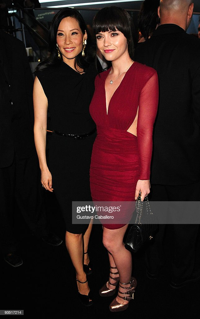 Actors Lucy Liu and Christina Ricci attends 'The Art of Progress' world premiere of the new Audi A8 at the Audi Pavilion on November 30, 2009 in Miami, Florida.