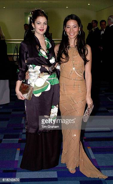 Actors Lucy Liu and Drew Barrymore at Movie Premiere Charlies' Angels in London Actresses Evening Dresses