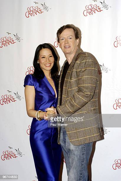 Actors Lucy Liu and Dylan Baker attend a photo call as part of the new cast of God Of Carnage at Sardi's on February 16 2010 in New York City