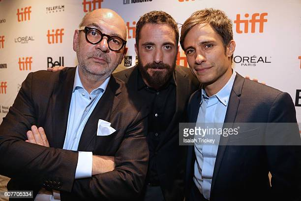 Actors Luis Gnecco Pablo Larrain and Gael Garcia Bernal pose before the screening of their film 'Neruda' during the 2016 Toronto International Film...