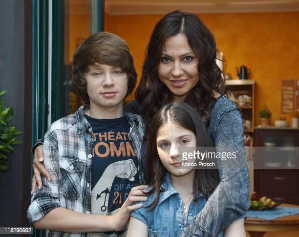 Actors Lukas Schust as Phillip Simone Thomalla as Sofie Becker and Alea Sophia Boudodimos as Jenny pose at the film set of 'Nach All Den Jahren' on...
