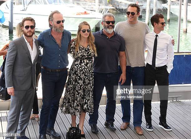 Actors Luke Bracey Hugo Weaving Teresa Palmer director Mel Gibson actors Vince Vaughn and Andrew Garfield arrive by boat to the Lido during the 73rd...