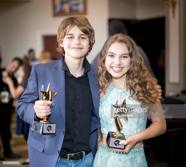 Actors Luke Colombero and Caitlin Carmichael display their awards at the 2nd Annual Young Entertainer Awards at The Globe Theatre on March 19 2017 in...