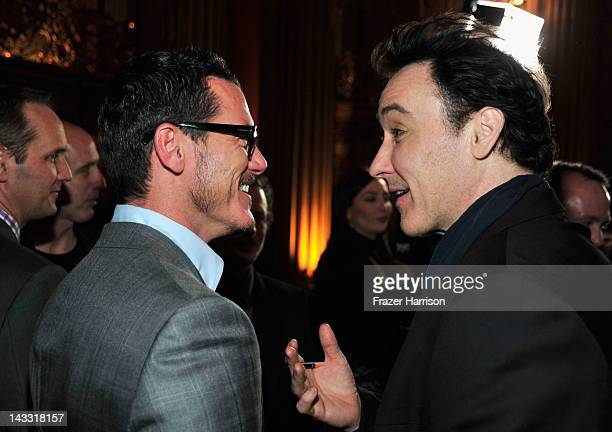 Actors Luke Evans and John Cusack arrive at the Los Angeles premiere of Relativity Media's The Raven held at the Los Angeles Theatre on April 23 2012...