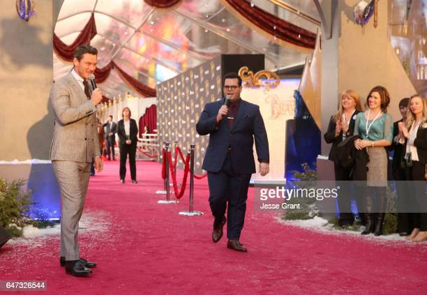 Actors Luke Evans and Josh Gad perform at the world premiere of Disney's liveaction Beauty and the Beast at the El Capitan Theatre in Hollywood as...