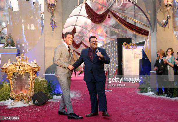 "Actors Luke Evans and Josh Gad perform at the world premiere of Disney's live-action ""Beauty and the Beast"" at the El Capitan Theatre in Hollywood as..."