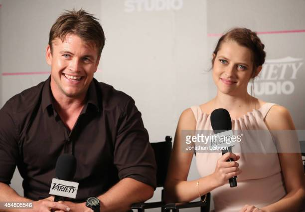Actors Luke Hemsworth and Teresa Palmer attend day 2 of the Variety Studio presented by Moroccanoil at Holt Renfrew during the 2014 Toronto...