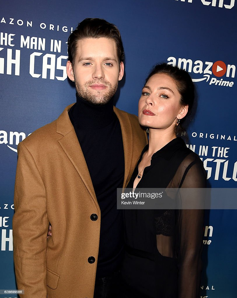 actors luke kleintank l and alexa davalos arrive at the premiere screening of amazons