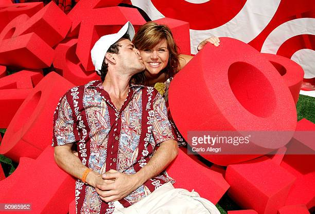 Actors Luke Perry and Tiffani Thiessen pose at the target crossword puzzle at the Target A Time for Heroes to Benefit the Elizabeth Glaser Pediatric...
