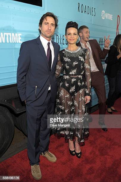 """Actors Luke Wilson, Carla Gugino and rapper Machine Gun Kelly attend the premiere for Showtime's """"Roadies"""" at The Theatre at Ace Hotel on June 6,..."""