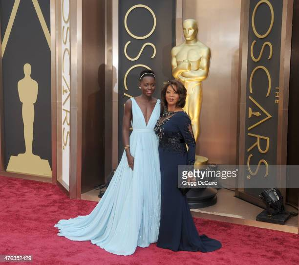 Actors Lupita Nyong'o and Alfre Woodard arrive at the 86th Annual Academy Awards at Hollywood Highland Center on March 2 2014 in Hollywood California