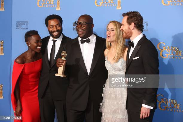 Actors Lupita Nyong'o and Chiwetel Ejiofor director Steve McQueen actors Sarah Paulson and Michael Fassbender pose in the press room of the 71st...