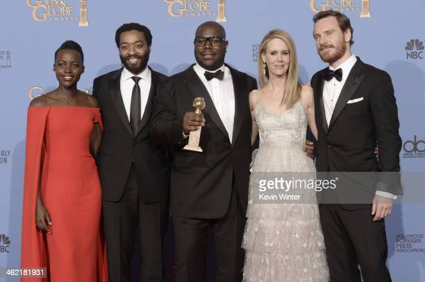 Actors Lupita Nyong'o and Chiwetel Ejiofor director Steve McQueen actors Sarah Paulson and Michael Fassbender winners of Best Motion Picture Drama...