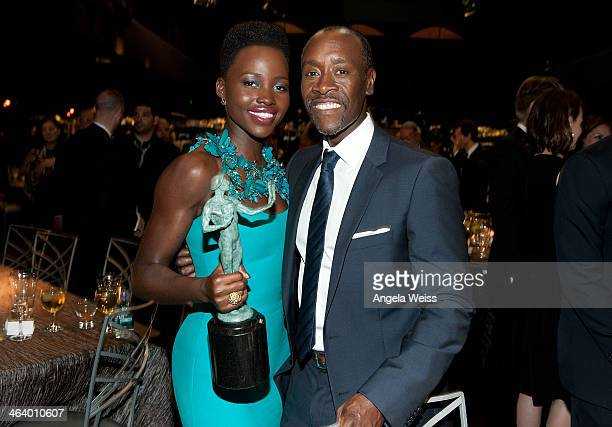 Actors Lupita Nyong'o and Don Cheadle attend the 20th Annual Screen Actors Guild Awards at The Shrine Auditorium on January 18 2014 in Los Angeles...
