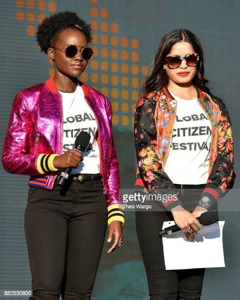 Actors Lupita Nyong'o and Freida Pinto speak onstage during the 2017 Global Citizen Festival in Central Park on September 23 2017 in New York City