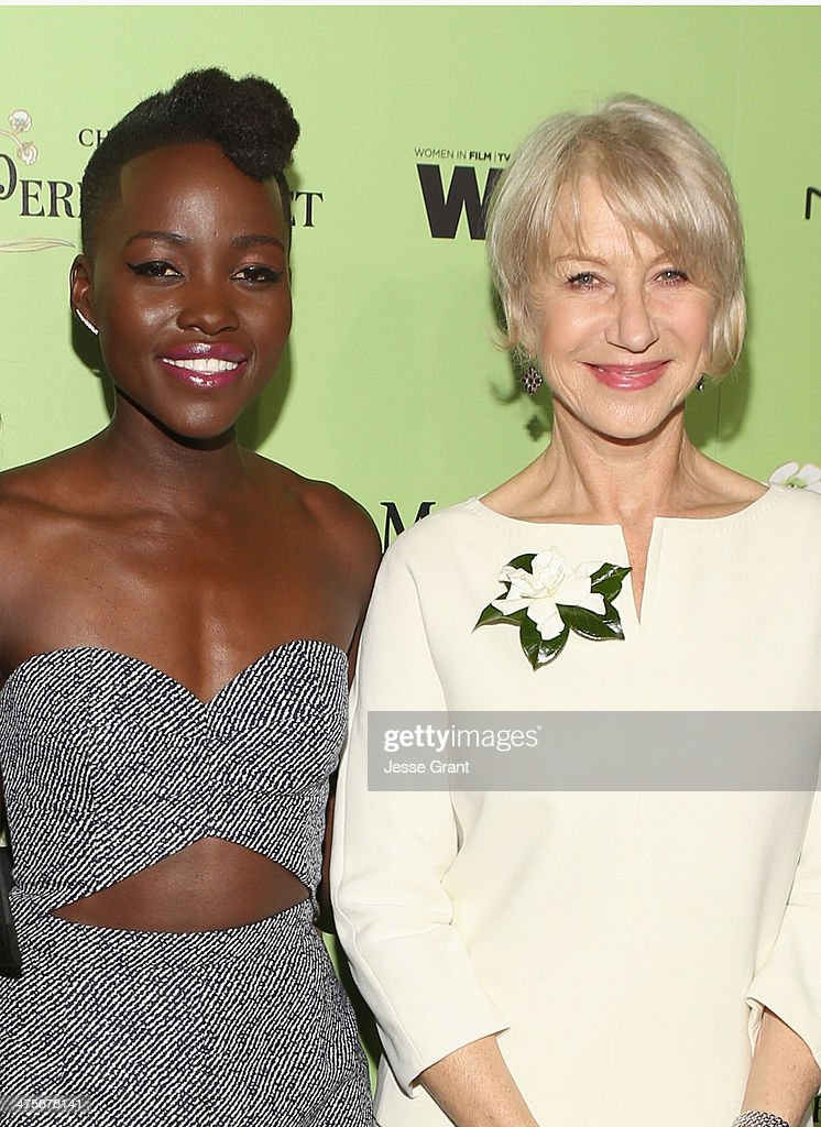 Actors Lupita Nyong'o (L) and Helen Mirren attend the Women In Film Pre-Oscar Cocktail Party presented by Perrier-Jouet, MAC Cosmetics & MaxMara at Fig & Olive Melrose Place on February 28, 2014 in West Hollywood, California.
