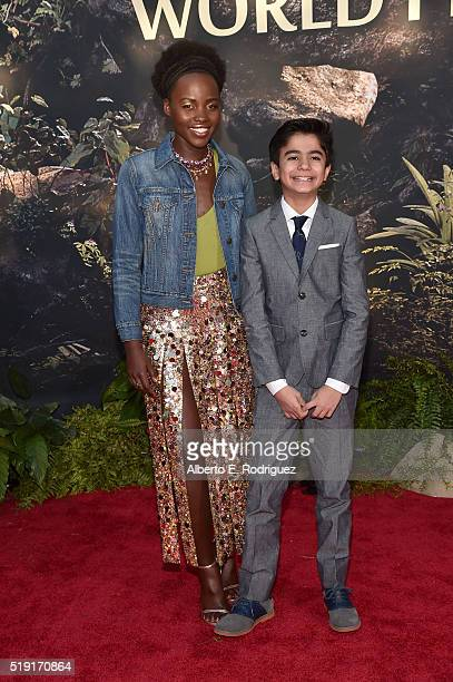 Actors Lupita Nyong'o and Neel Sethi attend The World Premiere of Disney's 'THE JUNGLE BOOK' at the El Capitan Theatre on April 4 2016 in Hollywood...