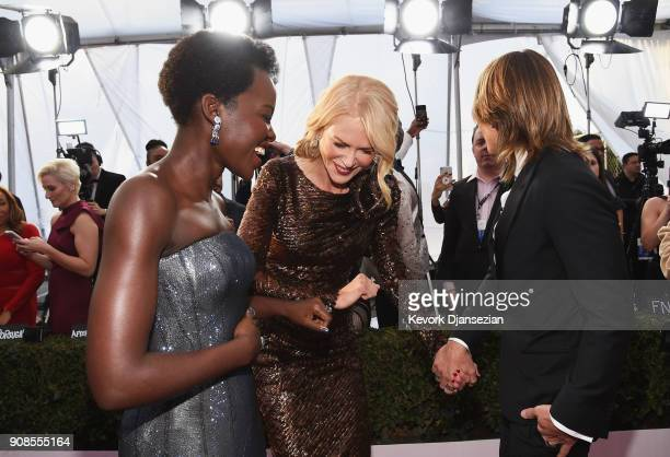 Actors Lupita Nyong'o Nicole Kidman and musician Keith Urban attends the 24th Annual Screen Actors Guild Awards at The Shrine Auditorium on January...
