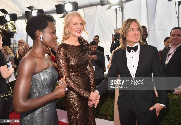 Actors Lupita Nyong'o Nicole Kidman and singer Keith Urban attend the 24th Annual Screen Actors Guild Awards at The Shrine Auditorium on January 21...