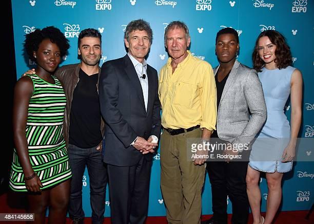 Actors Lupita Nyong'o Oscar Isaac Chairman of the Walt Disney Studios Alan Horn actors Harrison Ford John Boyega and Daisy Ridley of STAR WARS THE...