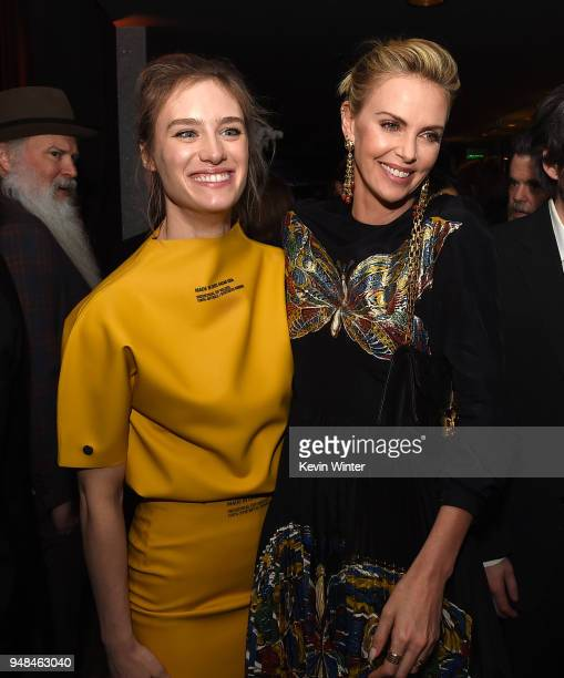 Actors Mackenzie Davis and Charlize Theron pose at the after party for the premiere of Focus Features' 'Tully' at WP24 on April 18 2018 in Los...